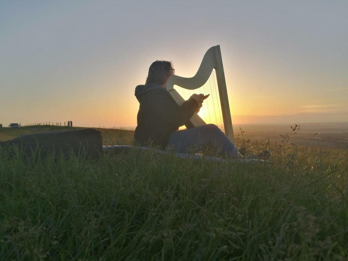 harp player at sunset